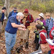 Bill Lattrell with students in field