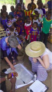 Jinny St. Goar (in purple top), Molly Burhans (in hat), Mme. Bintou Sissoko, and locals puzzle over base map questions.
